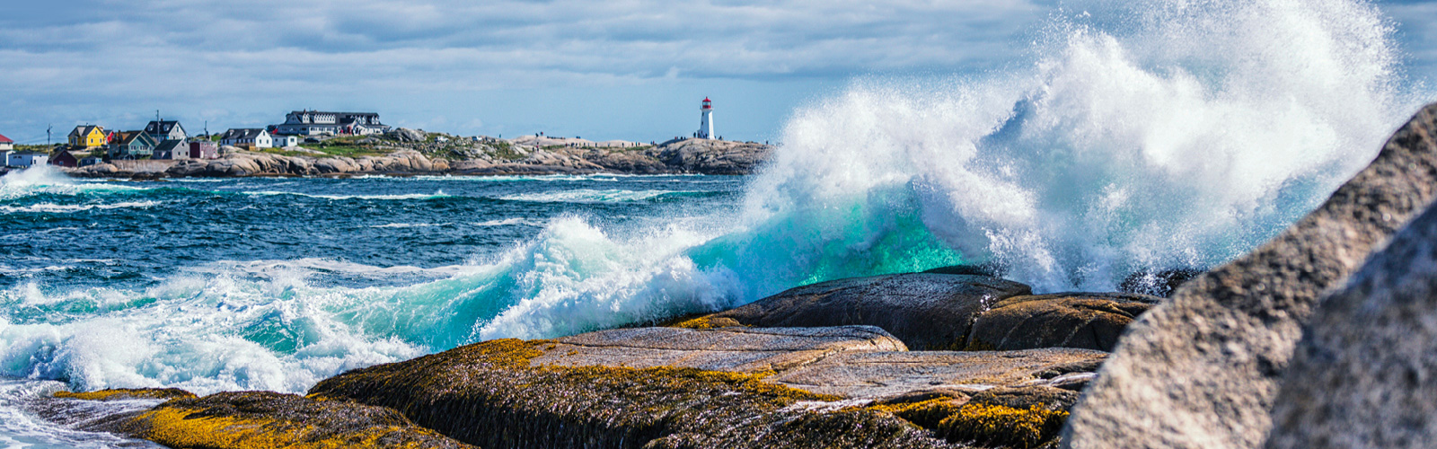 light house with waves on a rock