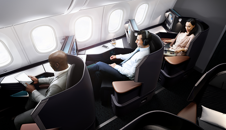 Aerial view of three guests relaxing in spacious business cabin pods on 787 Dreamliner aircraft