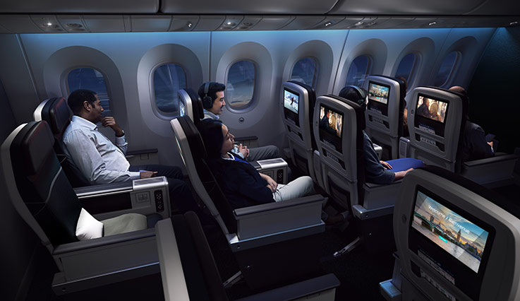 Rows of guests enjoying inflight entertainment on 787 Dreamliner aircraft