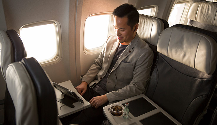 Guest enjoys extra space in Premium seats on a WestJet Boeing 737.