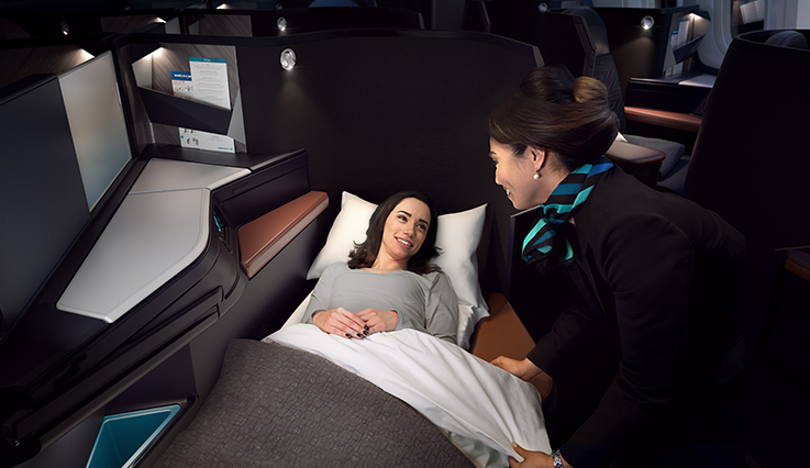Woman in Business Class lay-flat seats.