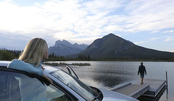 Banff mountain range overlooking a car
