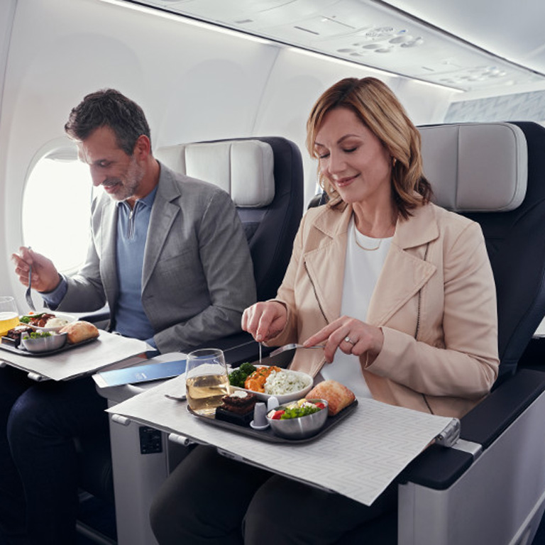 Man and woman enjoying an inflight meal