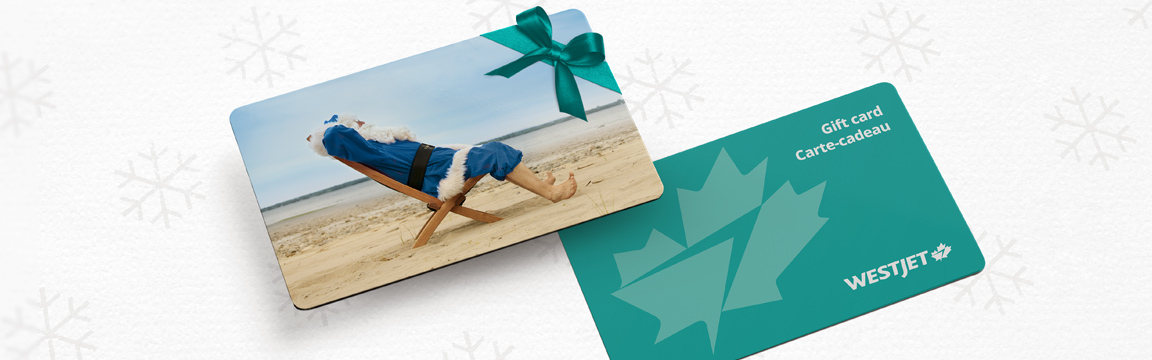 Blue Santa featured on WestJet holiday gift card lounging on beach