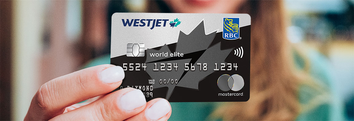 Woman holding the WestJet RBC World Elite Mastercard.