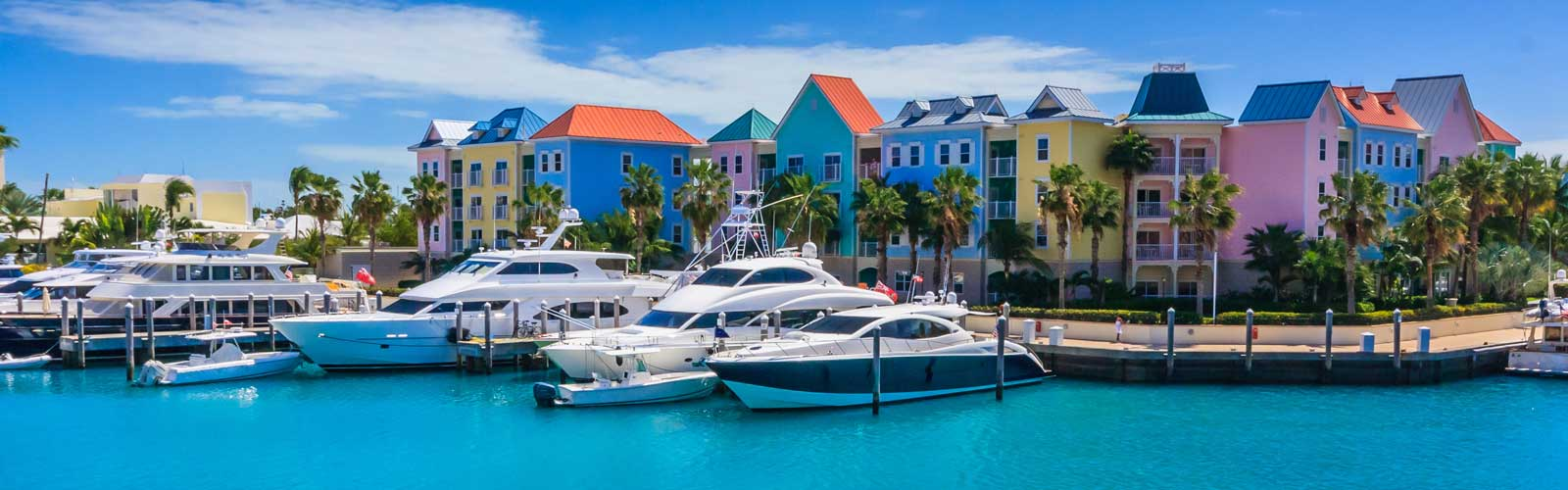 Colourful homes along ocean in Nassau, Bahamas.