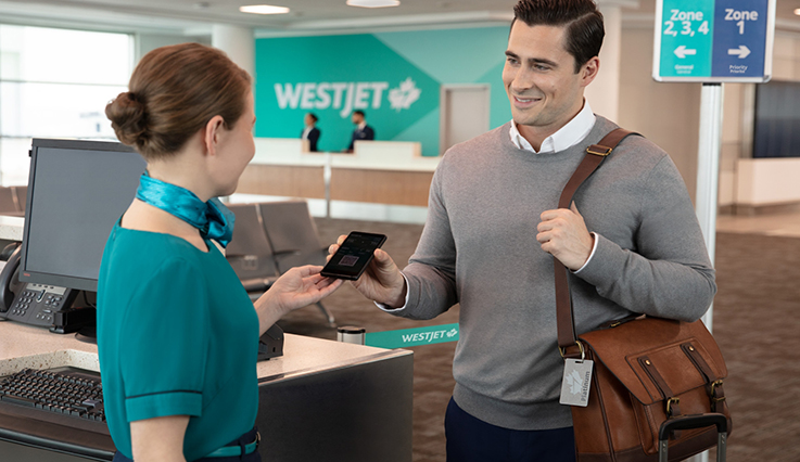 WestJet Rewards Platinum member boarding flight at gate using electronic boarding pass.