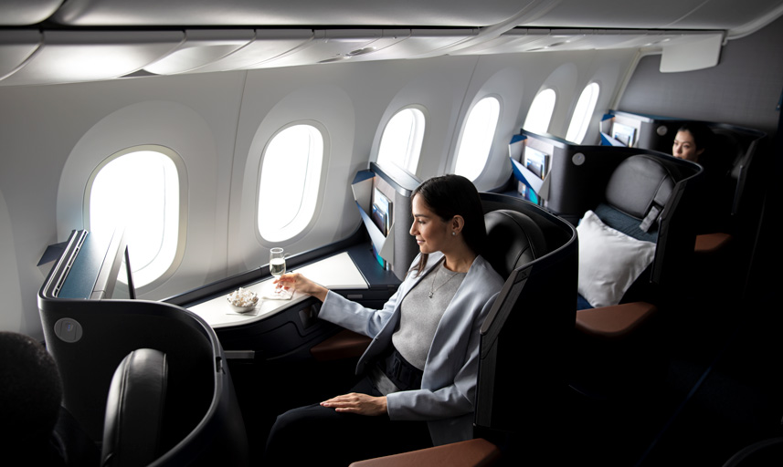 A guest in the 787-9's Business cabin enjoys on-demand dining service.