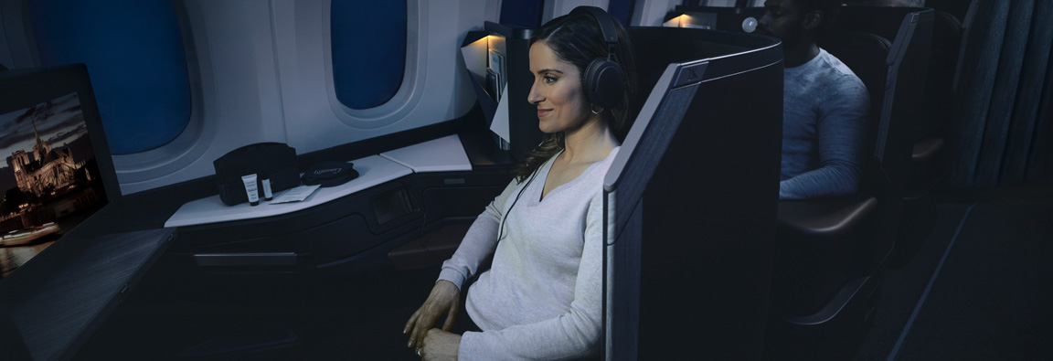 Guest enjoying inflight entertainment in a Business cabin pod onboard the WestJet 787 Dreamliner