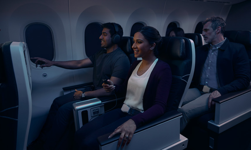 Guests in Premium watching inflight entertainment.