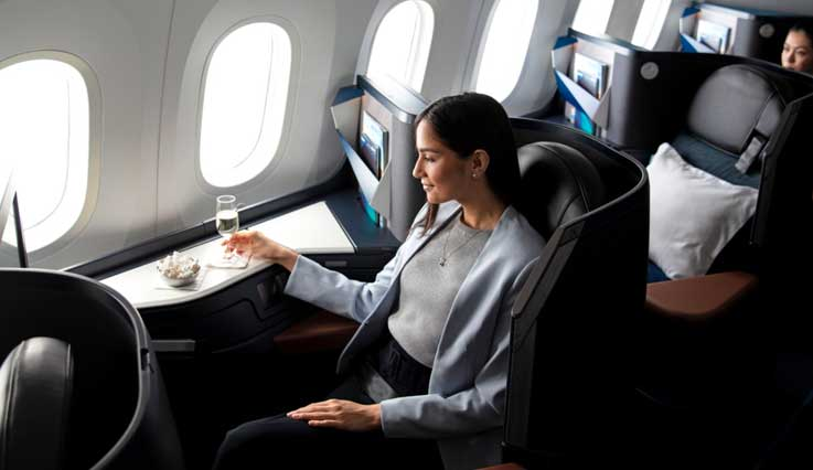 Guest seated in WestJet's Business cabin onboard the 787 Dreamliner