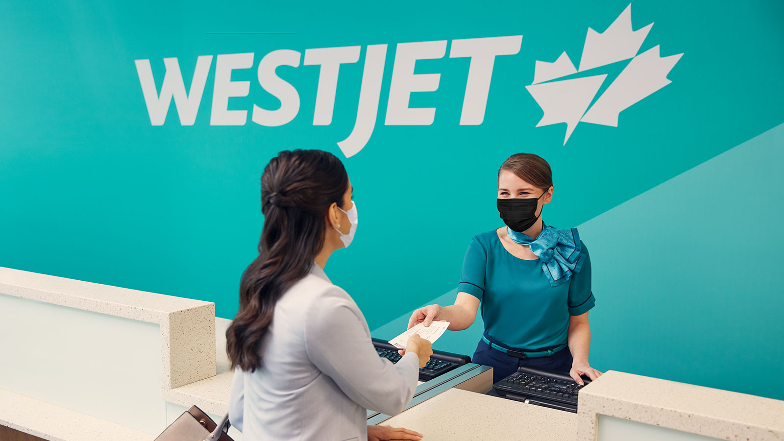 Guest talking with a WestJet agent.