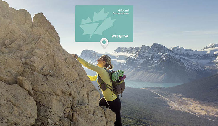 Gift card superimposed against a woman climbing a mountain.