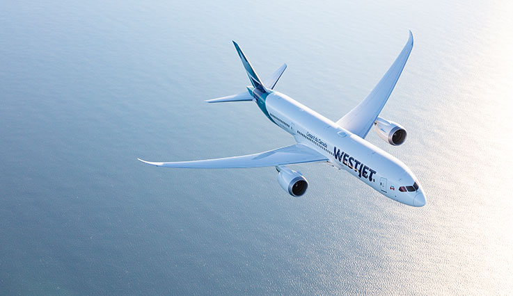 Image of a WestJet Boeing 787-9 in the air