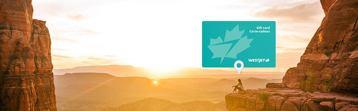 WestJet gift card shown above woman sitting on canyon edge.