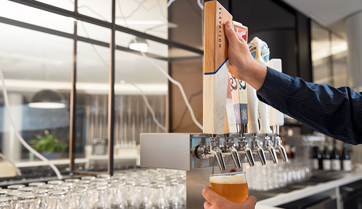 Bartender pouring Elevation draft