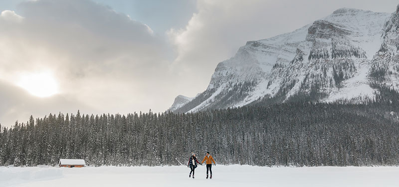 Couple skating with mountain backdrop