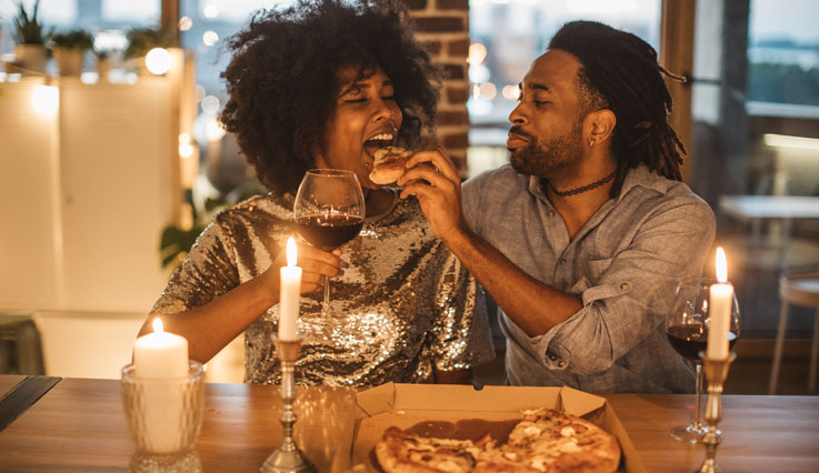 Couple enjoying pizza evening at home