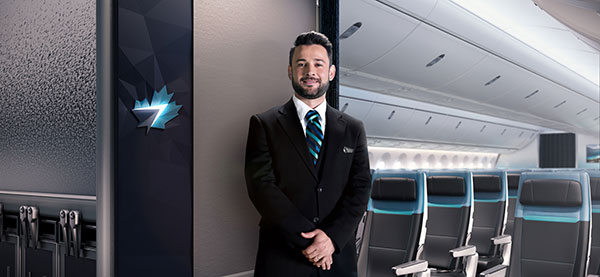 Flight attendant smiling for the camera onboard the 787 Dreamliner