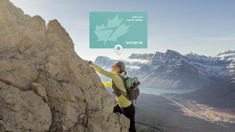 Gift card superimposed against a woman climbing a mountain