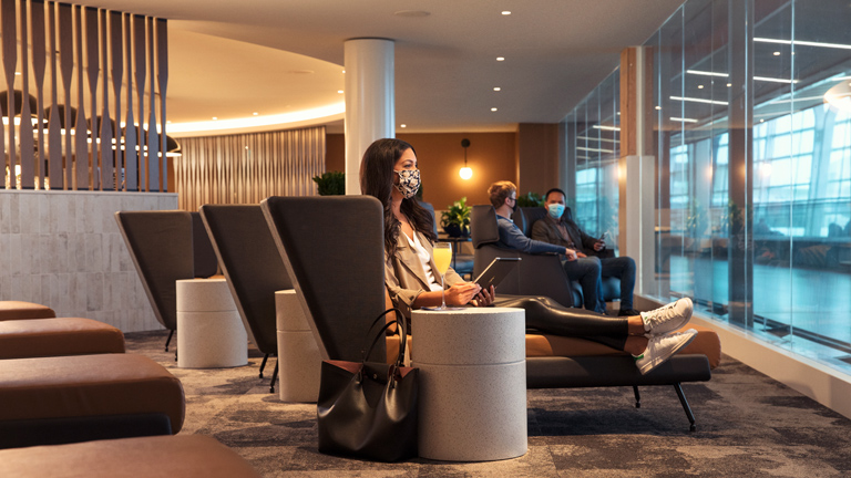 Woman relaxing in airport lounge