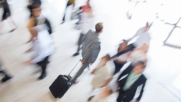 business man walking with small luggage