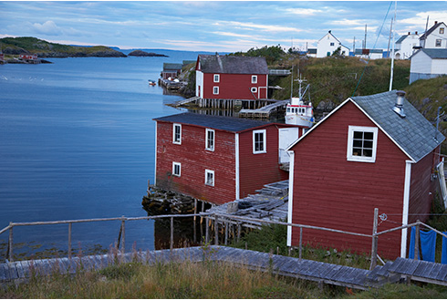 Showing slide 7 of 18 in image gallery, gander-newfoundland_red-boat-houses