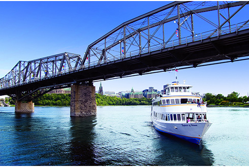 Showing slide 2 of 21 in image gallery, People enjoying a boat cruise down Ottawa River in the summer