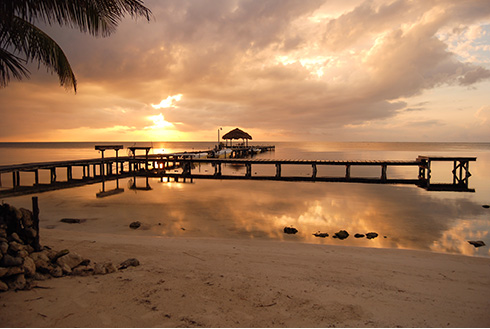 Showing slide 1 of 8 in image gallery, Sunrise on the coast of Belize