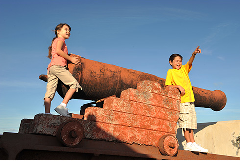Showing slide 12 of 25 in image gallery, Children with the Fort Fincastle Cannon in Nassau