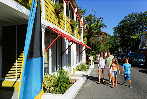 Showing slide 8 of 25 in image gallery, A family walking into the Graycliff Heritage Museum in Nassau
