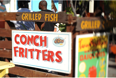 Showing slide 16 of 25 in image gallery, Outdoors restaurant featuring grilled fish in Nassau