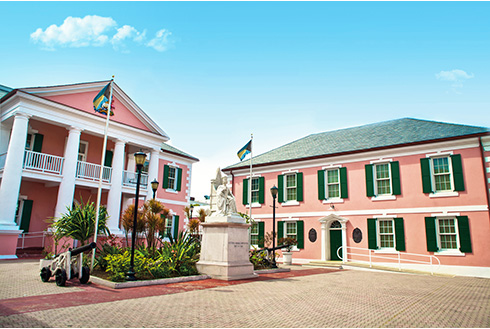 Showing slide 5 of 25 in image gallery, Pink buildings of Parliament Square in Nassau, Bahamas