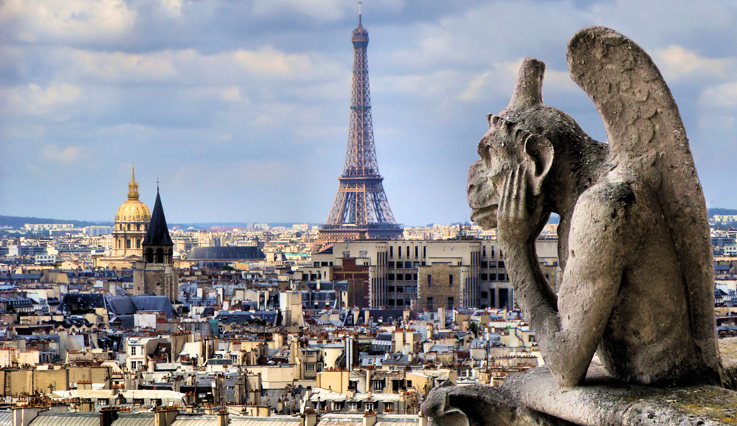 Notre dame gargoyle with Paris cityscape and Eiffel Tower
