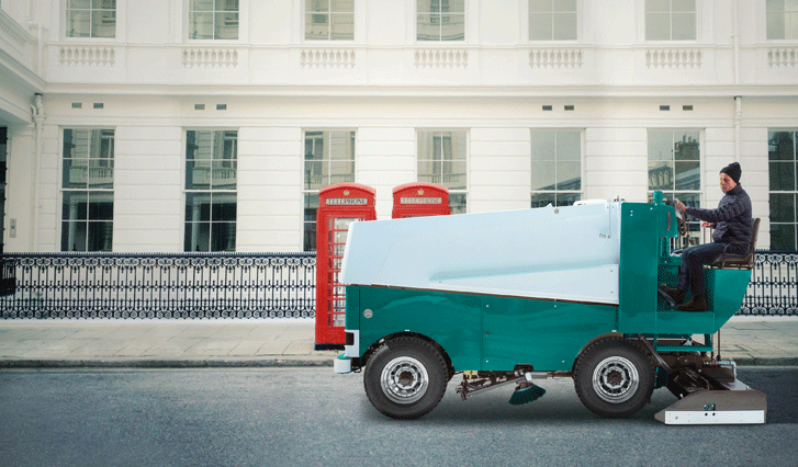 Man driving a Zamboni down a London street