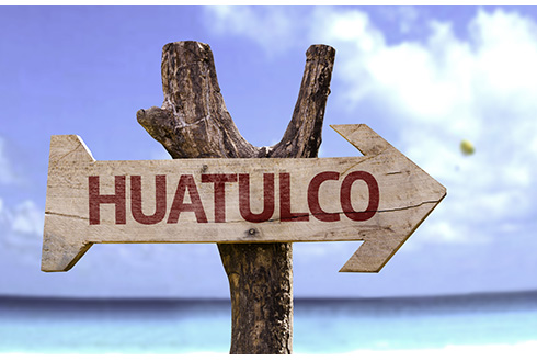Showing slide 4 of 8 in image gallery, Wooden sign that reads Huatulco pointing to a beach