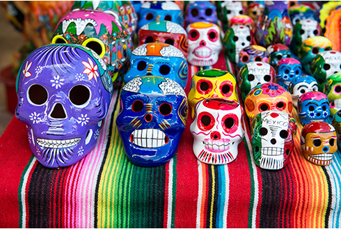 Showing slide 6 of 8 in image gallery, Traditional Mexican souvenir skulls at the market