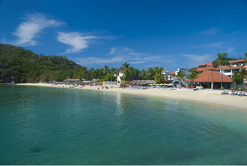 Showing slide 1 of 8 in image gallery, Shoreline of a beautiful tropical beach in Huatulco