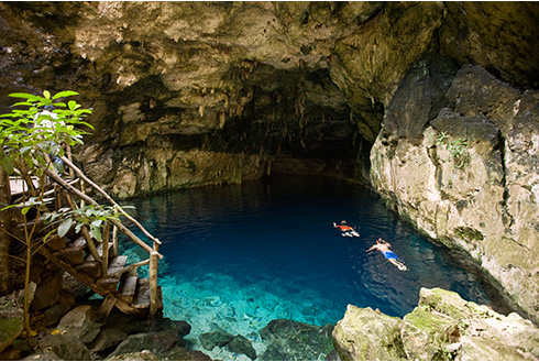 Showing slide 5 of 31 in image gallery, Cenotes with two snorkelers swimming in the Yucatán