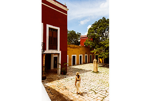 Showing slide 29 of 31 in image gallery, Woman walking outside of Hacienda Temozon