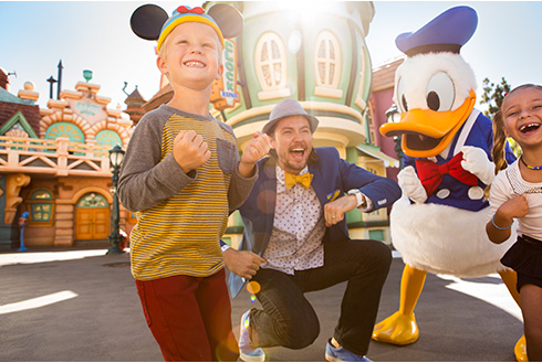 Showing slide 10 of 16 in image gallery, Donald and three guests dancing at Disneyland Resort in California
