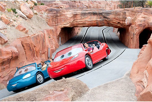 Showing slide 8 of 16 in image gallery, People enjoying the Radiator Springs Racers ride in Cars Land