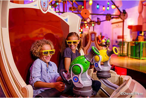 Showing slide 11 of 16 in image gallery, Two guests playing at Disneyland Resort on Toy Story Mania!