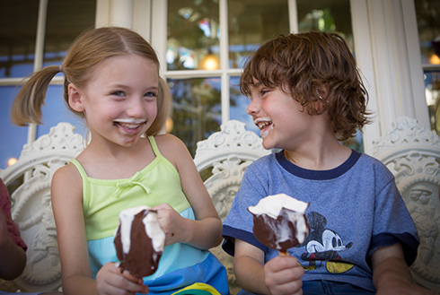 Showing slide 18 of 20 in image gallery, Two children eating ice cream at Downtown Disney