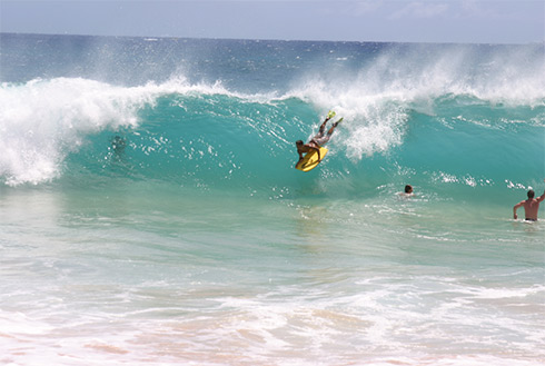Showing slide 19 of 24 in image gallery, Surfing off of Oahu's North Shore