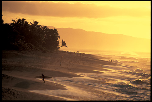 Showing slide 20 of 24 in image gallery, Surfing at sunset, Oahu