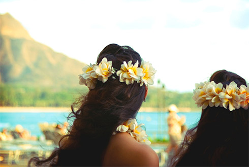 Showing slide 21 of 24 in image gallery, Girls with Wahine flowers in their hair, Honolulu, Oahu