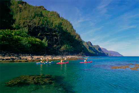 Showing slide 24 of 41 in image gallery, Kayakers near Kee Beach, Kauai