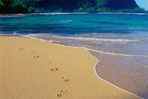 Showing slide 28 of 41 in image gallery, Footprints in sand, Makua Beach, Kauai