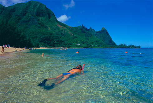 Showing slide 29 of 41 in image gallery, Woman snorkelling, Makua Beach, Kauai